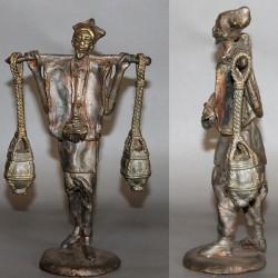 Porteur d'eau Dogon en bronze